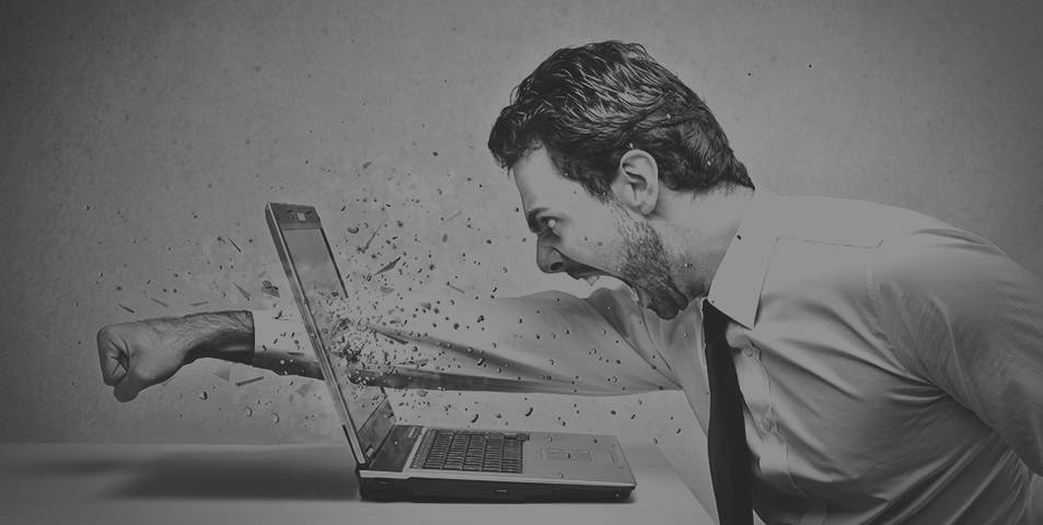An angry office worker punching his computer screen