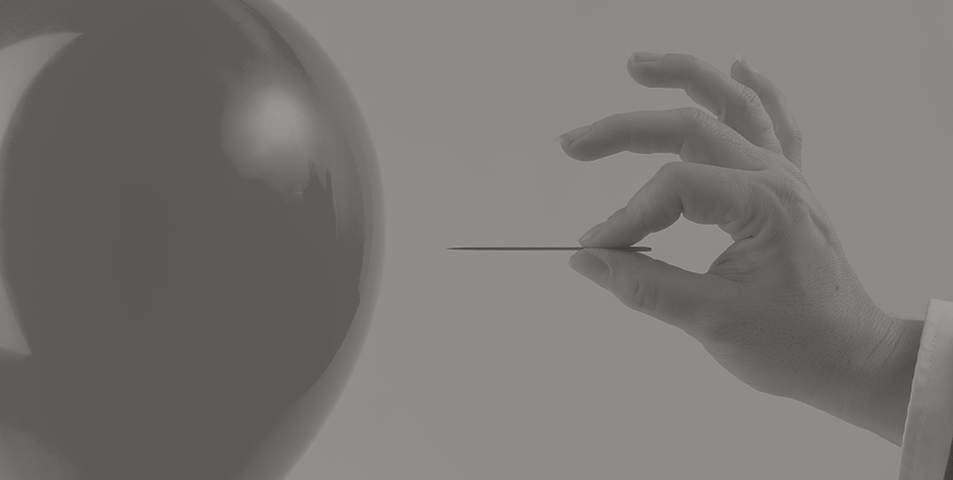 a hand with a needle about to pop a balloon